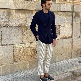 White Vertical Striped Chinos Outfits: The formula for effortlessly sleek menswear style? A navy double breasted blazer with white vertical striped chinos. And if you want to easily dress down your ensemble with a pair of shoes, why not complement this outfit with a pair of navy leather boat shoes?