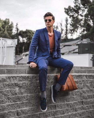 How to wear: navy vertical striped double breasted blazer, tobacco crew-neck t-shirt, navy vertical striped dress pants, black suede tassel loafers