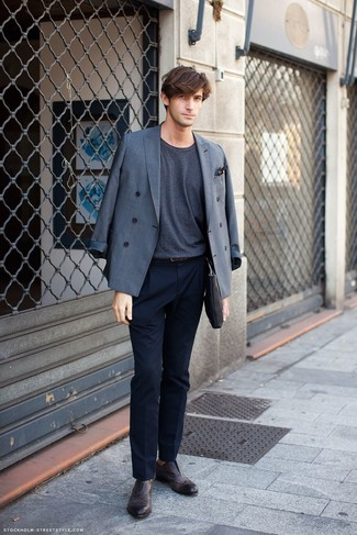 How to Wear a Belt For Men: Why not rock a grey double breasted blazer with a belt? As well as super functional, these pieces look good worn together. Up your whole getup by wearing a pair of dark brown leather brogues.