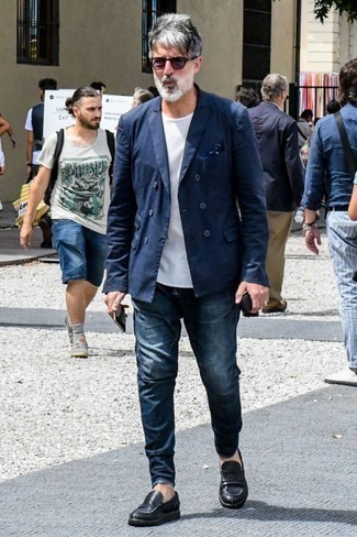 How to Wear a Navy Double Breasted Blazer For Men: This pairing of a navy double breasted blazer and navy jeans couldn't possibly come across as anything other than ridiculously sharp and effortlessly smart. Get a bit experimental when it comes to shoes and spruce up this ensemble by wearing black leather loafers.