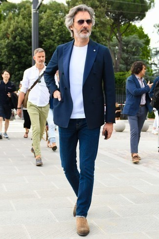 How to Wear a Navy Double Breasted Blazer For Men: Go for a casually classic outfit in a navy double breasted blazer and navy jeans. Amp up this whole ensemble by rocking a pair of tan suede chelsea boots.
