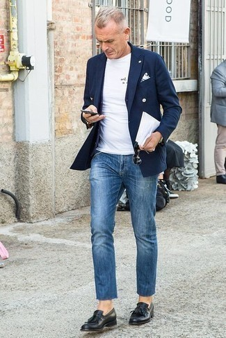 White Print Crew-neck T-shirt Outfits For Men: Show that no-one does off-duty quite like you do in a white print crew-neck t-shirt and blue ripped jeans. A cool pair of black fringe leather loafers is a simple way to bring a hint of polish to your look.