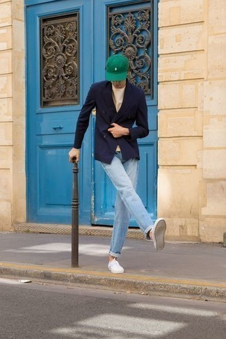 Baseball Cap Outfits For Men: Make a navy double breasted blazer and a baseball cap your outfit choice for a fuss-free ensemble that's also put together nicely. Complete this look with white canvas low top sneakers and the whole ensemble will come together really well.