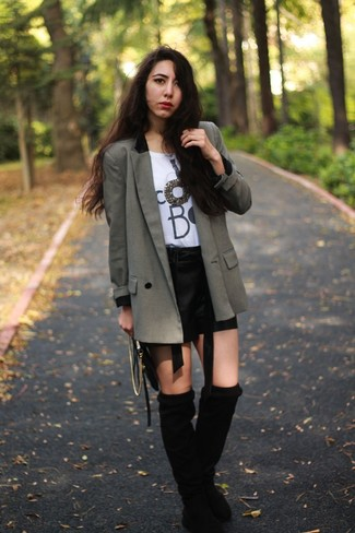 How to wear: grey double breasted blazer, white and black print crew-neck t-shirt, black leather shorts, black suede knee high boots