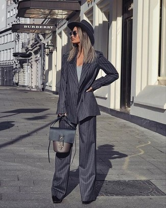 How to wear: charcoal vertical striped wool double breasted blazer, grey crew-neck t-shirt, charcoal vertical striped wide leg pants, black suede pumps