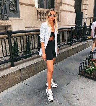 How to wear: grey plaid double breasted blazer, black cropped top, black bike shorts, white and black athletic shoes
