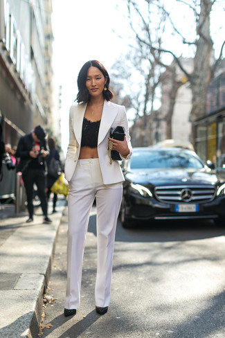 A white double breasted blazer and white slacks are appropriate for both smart casual events and day-to-day wear. A pair of black suede pumps fits right in here. So if you're looking for an insta-worthy outfit on a extremely hot day, this one fits the task well.