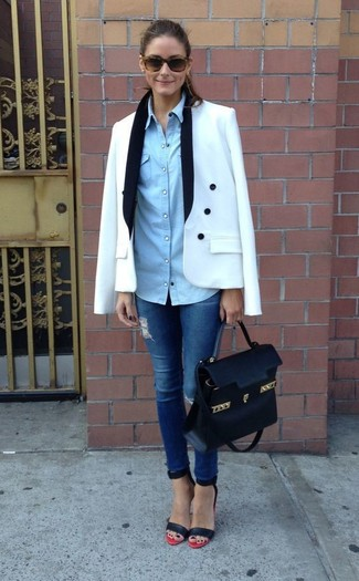 Team a white double breasted blazer with blue distressed slim jeans for both chic and easy-to-wear look. Red and black leather heeled sandals will add a touch of polish to an otherwise low-key look.