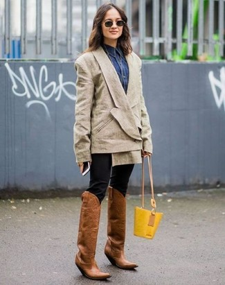 Dark Brown Leather Cowboy Boots Outfits For Women: A beige double breasted blazer and black skinny pants are a combo that every chic girl should have in her casual sartorial collection. Add dark brown leather cowboy boots to the equation to make a mostly classic outfit feel suddenly fresh.
