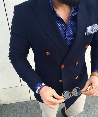 Try pairing a navy wool double breasted blazer with white chinos for a seriously stylish look. Sunnier days call for lighter combinations like this one.
