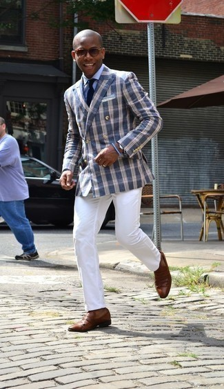How to Wear Brown Leather Loafers For Men: You're looking at the definitive proof that a navy plaid double breasted blazer and white chinos are awesome when married together. Brown leather loafers will put a different spin on this outfit.