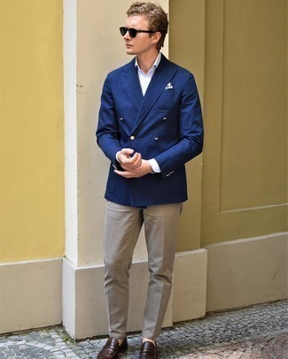 Navy Vertical Striped Double Breasted Blazer Outfits For Men: A navy vertical striped double breasted blazer and khaki chinos paired together are a match made in heaven. Dark brown leather loafers will give an added touch of style to an otherwise everyday outfit.