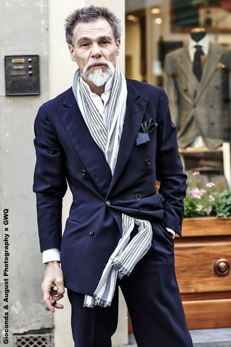 How to wear: navy double breasted blazer, white dress shirt, black dress pants, grey vertical striped scarf