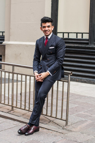 How to wear: navy vertical striped double breasted blazer, white dress shirt, navy vertical striped dress pants, burgundy leather oxford shoes