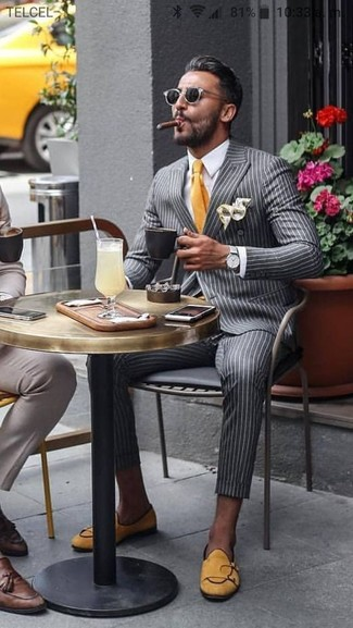 How to wear: grey vertical striped double breasted blazer, white dress shirt, grey vertical striped dress pants, yellow suede loafers