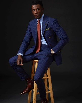 How to wear: blue vertical striped double breasted blazer, light blue dress shirt, blue vertical striped dress pants, burgundy leather derby shoes
