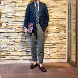 How to wear: navy double breasted blazer, white and blue vertical striped dress shirt, grey dress pants, burgundy leather tassel loafers