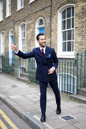 How to Wear a Navy Double Breasted Blazer For Men: This combo of a navy double breasted blazer and navy dress pants will add masculine essence to your outfit. Here's how to add a more casual spin to this look: black leather derby shoes.