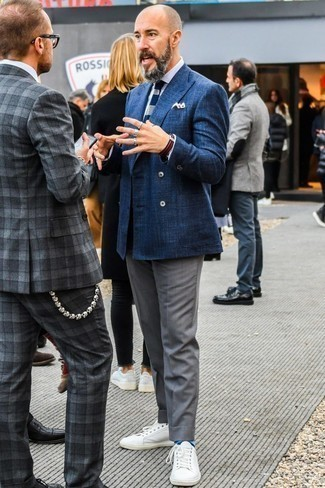 Men's Looks & Outfits: What To Wear In 2020: A navy double breasted blazer and grey dress pants are absolute must-haves if you're crafting a smart wardrobe that holds to the highest men's fashion standards. White leather low top sneakers are the most effective way to bring a hint of stylish effortlessness to your outfit.