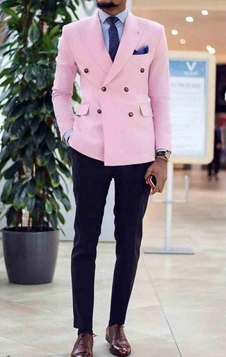 How to Wear a Navy Polka Dot Tie For Men: A pink double breasted blazer and a navy polka dot tie are worth being on your list of essential menswear pieces. Now all you need is a great pair of burgundy leather oxford shoes to finish your ensemble.