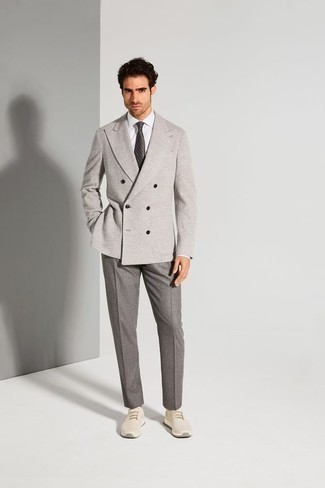 Men's Looks & Outfits: What To Wear In 2020: Consider teaming a grey double breasted blazer with grey dress pants for a proper elegant outfit. If you don't want to go all out formal, complement your ensemble with beige athletic shoes.