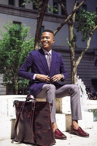 Violet Silk Tie Outfits For Men: To look like a sharp gentleman, pair a violet double breasted blazer with a violet silk tie. Take an otherwise classic ensemble in a sportier direction by sporting burgundy leather loafers.