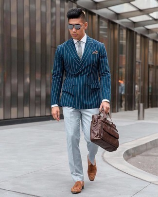 Brown Suede Loafers Outfits For Men: Combining a navy vertical striped double breasted blazer with grey dress pants is an amazing idea for a classic and refined look. To bring a laid-back touch to your outfit, complement your outfit with a pair of brown suede loafers.