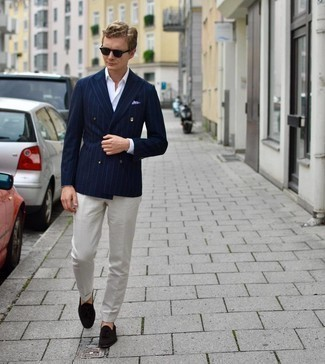 Navy Vertical Striped Double Breasted Blazer Outfits For Men: This combination of a navy vertical striped double breasted blazer and white dress pants epitomizes polish and class. A pair of dark brown suede tassel loafers easily bumps up the street cred of your ensemble.