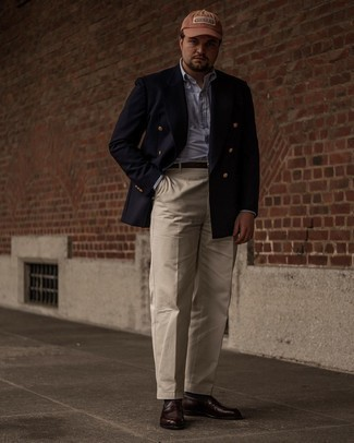 Men's Outfits 2021: Undeniable proof that a navy double breasted blazer and beige dress pants are awesome when combined together in an elegant look for today's man. Hesitant about how to finish? Introduce dark brown leather loafers to the mix to change things up a bit.