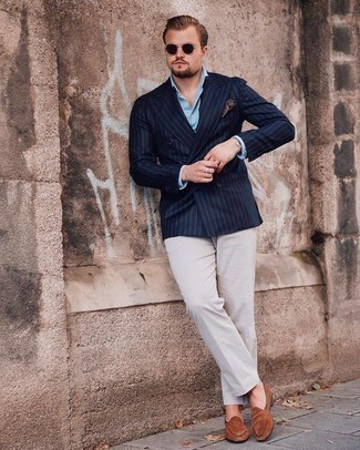 Navy Vertical Striped Double Breasted Blazer Outfits For Men: Marrying a navy vertical striped double breasted blazer and white dress pants is a guaranteed way to inject a classy touch into your day-to-day lineup. Not sure how to finish? Complement your ensemble with a pair of brown suede loafers for a more laid-back twist.