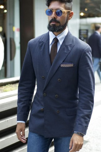 How to wear: navy double breasted blazer, light blue dress shirt, blue jeans, dark brown tie