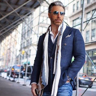 How to wear: navy cotton double breasted blazer, white dress shirt, blue jeans, beige scarf