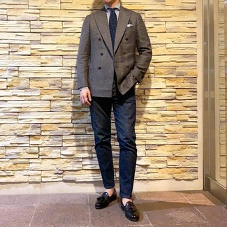 How to wear: dark brown double breasted blazer, white and blue vertical striped dress shirt, navy jeans, black leather tassel loafers