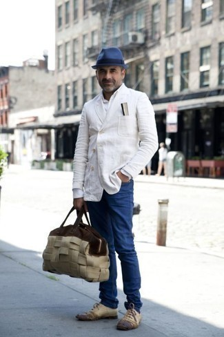How to Wear a White Double Breasted Blazer For Men: A white double breasted blazer and blue jeans are absolute must-haves if you're planning a smart casual closet that holds to the highest sartorial standards. Feeling venturesome today? Jazz things up by sporting a pair of beige leather oxford shoes.