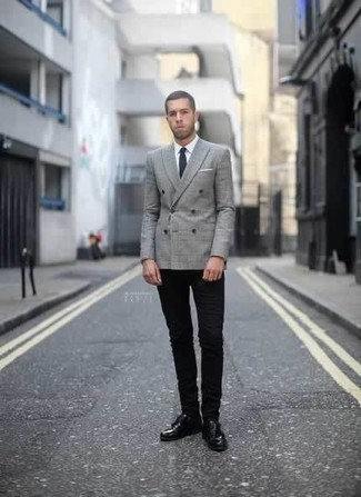 How to Wear Black Skinny Jeans For Men: Try teaming a grey plaid double breasted blazer with black skinny jeans to achieve new heights in menswear styling. Finishing off with a pair of black leather derby shoes is an effortless way to add some extra depth to your ensemble.