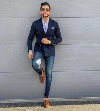 Blue Skinny Jeans Outfits For Men: A navy double breasted blazer and blue skinny jeans paired together are a savvy match. Why not complement this ensemble with a pair of brown leather tassel loafers for an added touch of style?