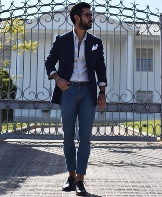 Blue Skinny Jeans Outfits For Men: Make a stylish statement anywhere you go in a navy double breasted blazer and blue skinny jeans. Tap into some David Beckham stylishness and polish up your outfit with black leather oxford shoes.