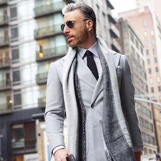 How to wear: grey double breasted blazer, white and black vertical striped dress shirt, black polka dot tie, grey scarf