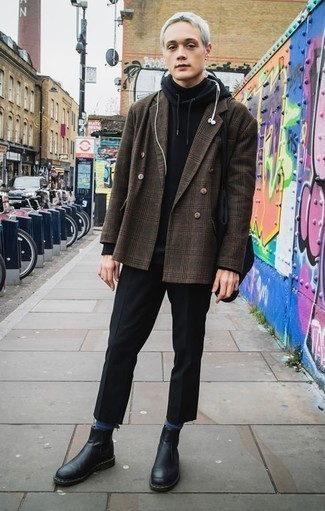 How to Wear a Black Hoodie For Men: Pair a black hoodie with black chinos to put together an incredibly dapper and current casual ensemble. Black leather chelsea boots are an effective way to add a little kick to the outfit.