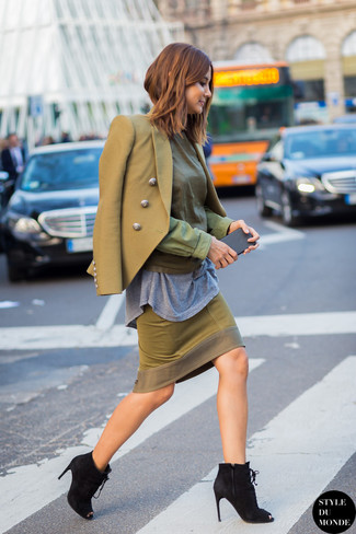An olive green double breasted blazer and an army green pencil skirt are a combination that every stylish girl should have in her wardrobe. For the maximum chicness make black cutout suede lace-up ankle boots your footwear choice.