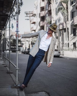 How to wear: grey double breasted blazer, white long sleeve henley shirt, navy dress pants, dark brown suede loafers