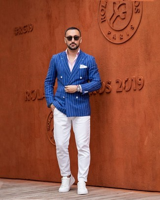 How to wear: blue vertical striped double breasted blazer, pink long sleeve shirt, white chinos, white leather low top sneakers