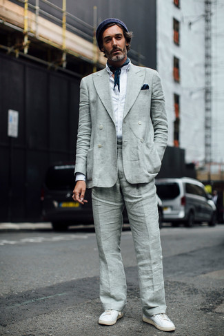 How to wear: grey linen double breasted blazer, white long sleeve shirt, grey linen dress pants, white leather low top sneakers