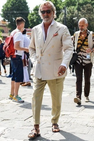 How to Wear Dress Pants For Men: This refined pairing of a beige double breasted blazer and dress pants is a favored choice among the style-conscious gentlemen. Complement your look with a pair of dark brown leather sandals to add a hint of stylish effortlessness to your look.