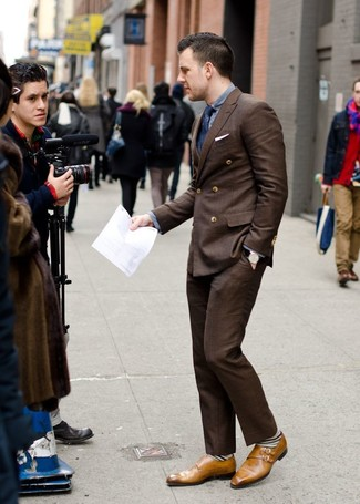 How to wear: dark brown double breasted blazer, grey long sleeve shirt, dark brown dress pants, tan leather double monks