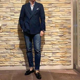 How to wear: navy double breasted blazer, white vertical striped long sleeve shirt, navy jeans, black leather tassel loafers