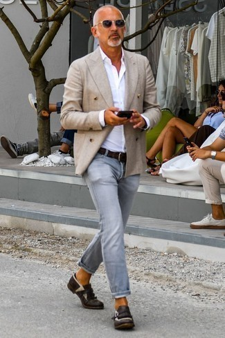 How to Wear Dark Brown Leather Monks: A beige double breasted blazer and grey jeans are among those versatile items that have become the key elements in any gent's wardrobe. Dark brown leather monks will take this getup in a more elegant direction.