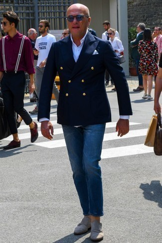 How to Wear a Navy Double Breasted Blazer For Men: Such staples as a navy double breasted blazer and navy jeans are an easy way to inject a hint of rugged refinement into your off-duty arsenal. You could perhaps get a little creative with footwear and complete your outfit with grey suede double monks.