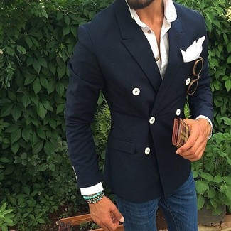 How to wear: navy double breasted blazer, white long sleeve shirt, blue skinny jeans, white pocket square