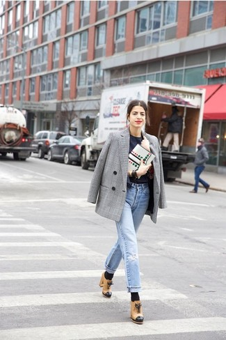 Master the effortlessly chic look in a grey plaid double breasted blazer and light blue distressed boyfriend jeans. Elevate this ensemble with khaki leather ankle boots.